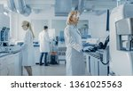 team of research scientists... | Shutterstock . vector #1361025563