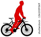 silhouette of a cyclist male on ... | Shutterstock . vector #1361039369