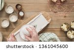 flat lay. slicing organic gold... | Shutterstock . vector #1361045600