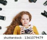 little girl with retro photo...   Shutterstock . vector #1361079479