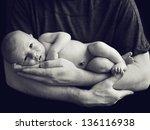 Newborn Baby In Dad's Hands
