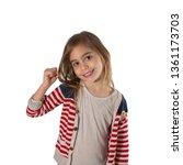 portrait of a happy girl making ...   Shutterstock . vector #1361173703
