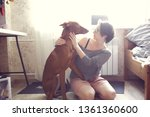 a woman with a pharaoh's dog is ... | Shutterstock . vector #1361360600