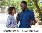 young happy couple wearing... | Shutterstock . vector #1361409560