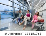 a family of three sitting in a... | Shutterstock . vector #136151768