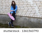 teen girl with pink penny skate ...   Shutterstock . vector #1361563793