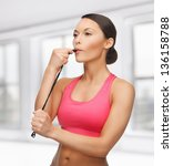 sporty woman with whistle... | Shutterstock . vector #136158788