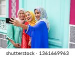 happy arabian friends using... | Shutterstock . vector #1361669963