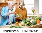 cheerful senior couple eating...   Shutterstock . vector #1361709539
