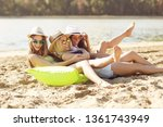 girlfriends playing on the... | Shutterstock . vector #1361743949