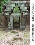 Small photo of Blocked and inaccessible door, way through a ancient temple. Abandoned and forsaken. In the jungle of cambodia, close to the tmples of angkor wat.