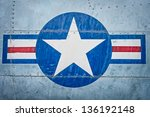 Part of military airplane with United States Air Force sign. Big white star in blue circle with stripes aside. War aircraft in metal plates. Military aviation. Retro style. Safety and protection.