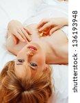 blond beautiful woman in bed...   Shutterstock . vector #136193948