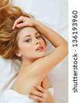 sexy young woman in bed   Shutterstock . vector #136193960