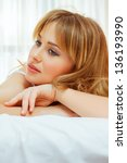 blond woman think in bed | Shutterstock . vector #136193990