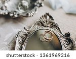 wedding rings lie on a vintage... | Shutterstock . vector #1361969216