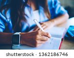 cropped image of woman writing...   Shutterstock . vector #1362186746