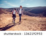mother and daughter hiking on... | Shutterstock . vector #1362192953