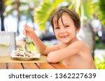 sweet preschool boy  eating... | Shutterstock . vector #1362227639