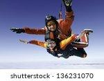 skydiving photo. tandem. | Shutterstock . vector #136231070