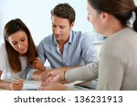 couple signing real estate... | Shutterstock . vector #136231913