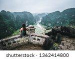 a woman overlooks the mountains ... | Shutterstock . vector #1362414800