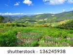 mountain range under blue sky... | Shutterstock . vector #136245938
