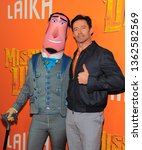 Small photo of New York, NY - April 7, 2019: Hugh Jackman and a cartoon character form the movie attend Missing Link New York premiere at Regal Cinema Battery Park