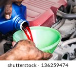 hand pouring transmission fluid ... | Shutterstock . vector #136259474