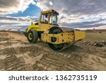Small photo of Steamroller performing leveling work on a road under construction