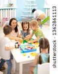 teacher helping kids playing...   Shutterstock . vector #1362861113