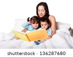 mother reading bed time story... | Shutterstock . vector #136287680
