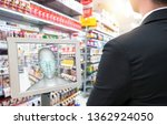 Small photo of Smart retail in futuristic use iot technology concepts. Customer use facial recognition application to login to system to buy,search special price product for security reason with face payment.