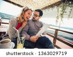 young cheerful man and woman... | Shutterstock . vector #1363029719