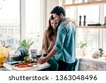 she is the center of his... | Shutterstock . vector #1363048496