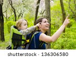 a young woman trekking with her ... | Shutterstock . vector #136306580
