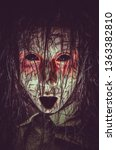 Small photo of Scary infernal cursed girl with black eyes opened mouth and cracked skin close-up portrait. Creepy demonic creature from hell