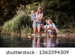young family with two toddler... | Shutterstock . vector #1363394309