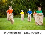 happy kids having potato sack... | Shutterstock . vector #1363404050