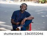 young man listens to music with ... | Shutterstock . vector #1363552046