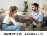 serious young couple sitting... | Shutterstock . vector #1363683740