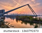 Small photo of Pedestrian bridge on parliament river in Dusseldorf - media harbor at sunset - Rheinpark Bilk