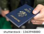 hand holding us passport for... | Shutterstock . vector #1363948880