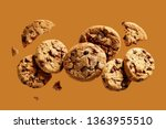 Small photo of Broken chocolate chip cookies. Cookies broken in pieces with crumbs.