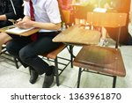 Small photo of Absent student's desk in university classroom - educational concept image of lecture room or training center with an empty desk that the student doesn't attend the lesson