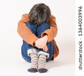 troubled child looking down | Shutterstock . vector #1364003996