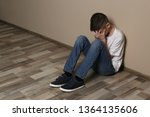 upset boy sitting on floor at... | Shutterstock . vector #1364135606