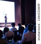Small photo of Presenter Presenting Business Presentation. Conference Speaker Photo. Tech Seminar Discussion. Executive Manager at Venture Capital Investor Pitch Forum. Corporate Technology Business Entrepreneurs.