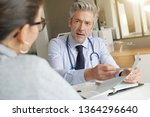 doctor going through results... | Shutterstock . vector #1364296640
