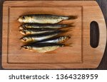Stock photo several baltic herrings cold smoked on a wooden cutting board several aromatic baltic herrings 1364328959